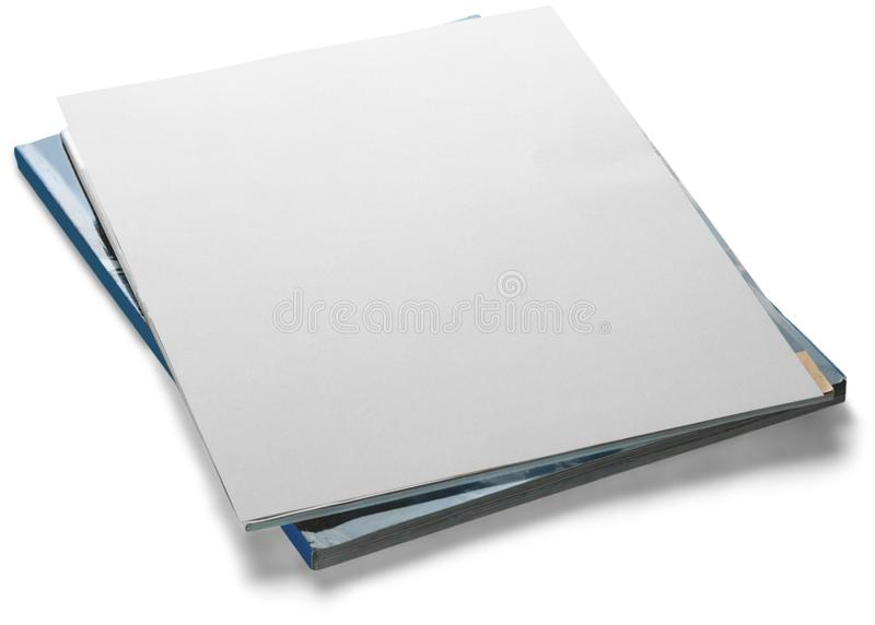 Stack of papers and magazines with a blank cover stock photo
