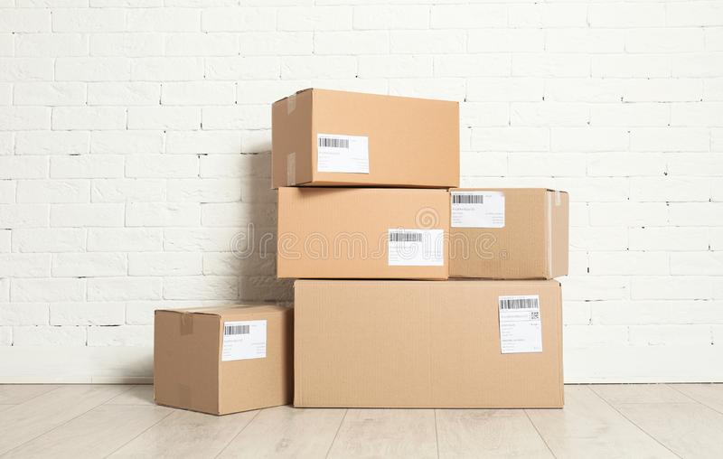 Stack of parcel boxes on floor royalty free stock photos