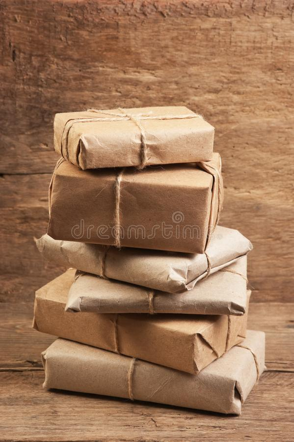 Stack parcel  in warehouse. Pile parcel wrapped with brown kraft paper and tied with twine royalty free stock photo