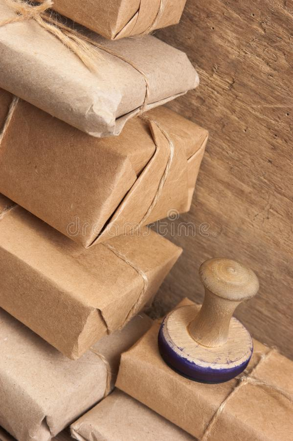 Stack parcel  in warehouse. Pile parcel wrapped with brown kraft paper and tied with twine royalty free stock images