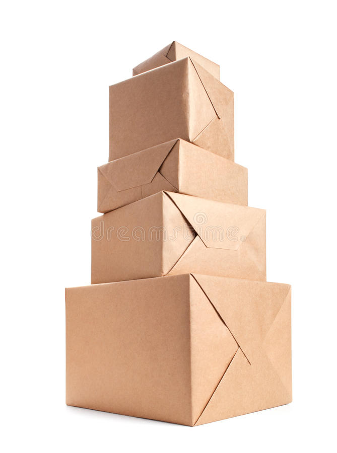 Stack of parcel wrapped with brown packing paper stock image