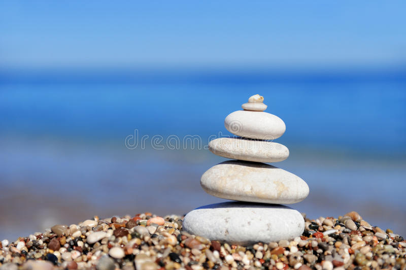 Stack of pebbles. Stack of pebble stones at the beach in the form of towers royalty free stock photo