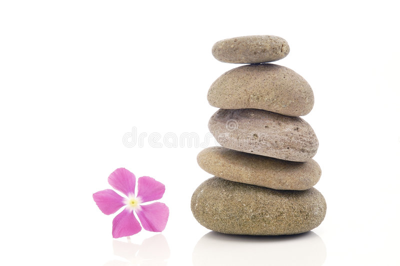 Stack of pebbles with pink flower royalty free stock image