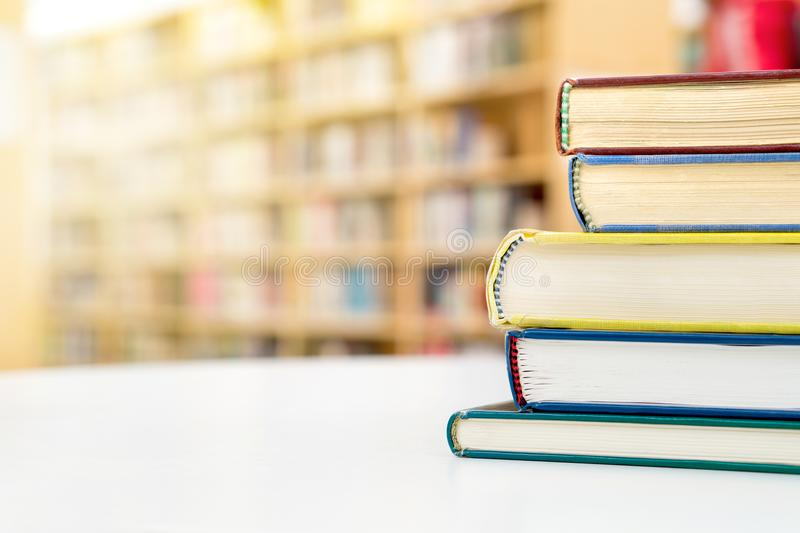 Stack and pile of books on tableublic or school library. in p stock photo