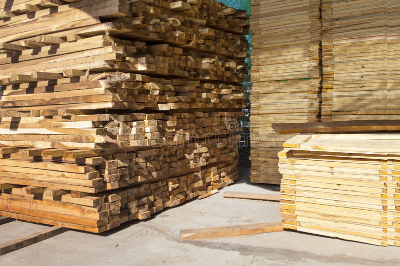 Stack of pile wood bar in lumber yard factory use for construction wood industry stock photos