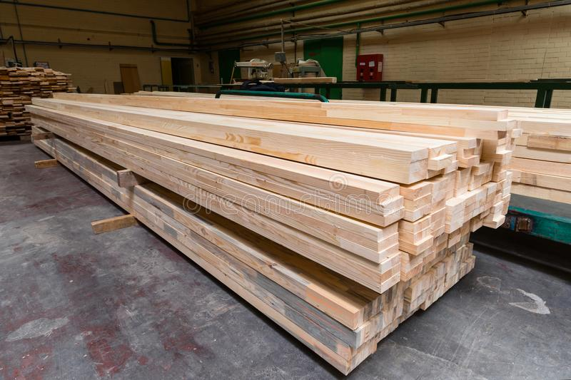 Stack of pile wood bar in lumber yard factory used in wood-processing industry stock photos