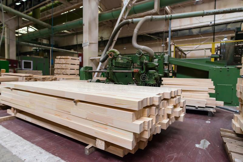 Stack of pile wood bar in lumber yard factory used in wood-processing industry stock photography