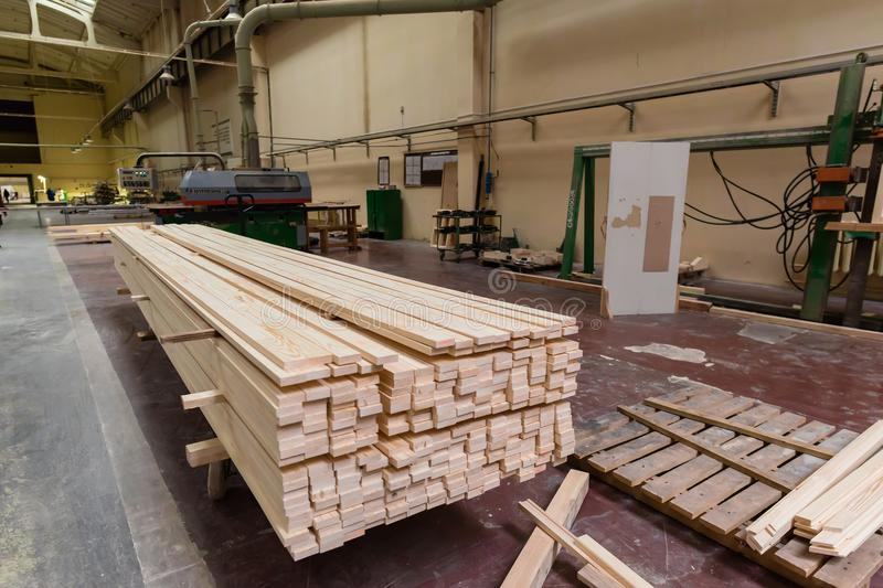 Stack of pile wood bar in lumber yard factory used in wood-processing industry royalty free stock images