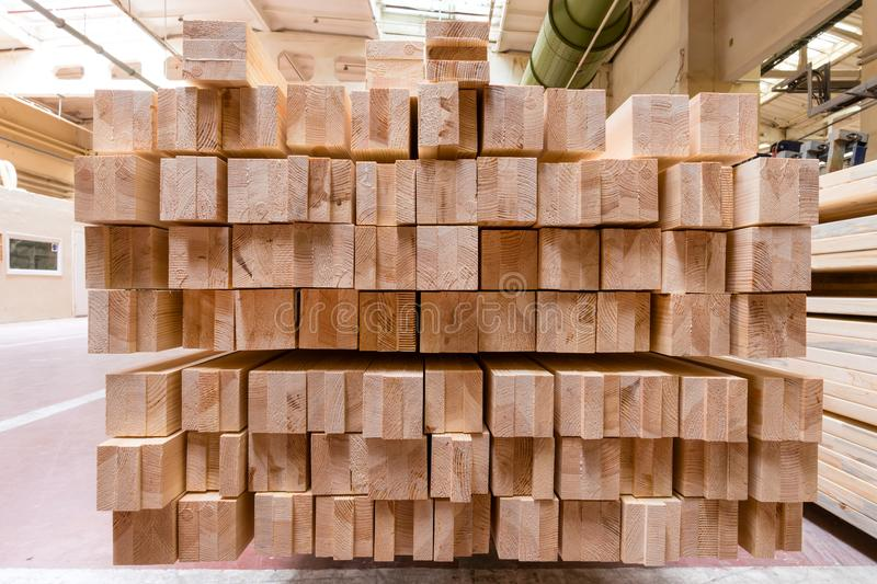 Stack of pile wood bar in lumber yard factory used in wood-processing industry royalty free stock photos