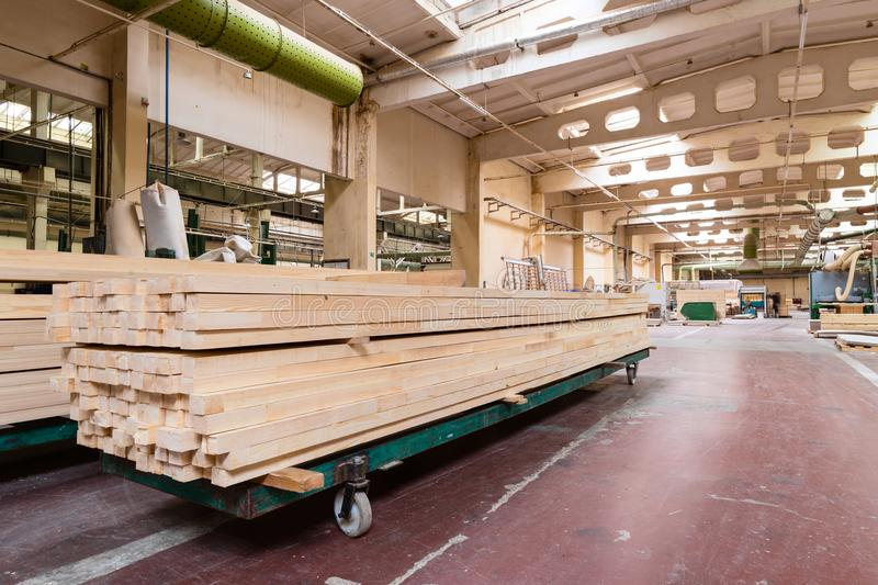 Stack of pile wood bar in lumber yard factory used in wood-processing industry stock image