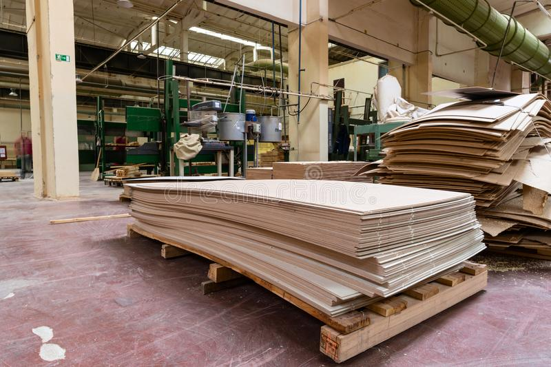 Stack of pile wood bar in lumber yard factory used in wood-processing industry royalty free stock photo