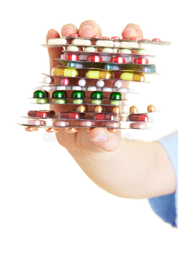 Stack of pills. Nurse holding many colorful pills in her hands royalty free stock photo