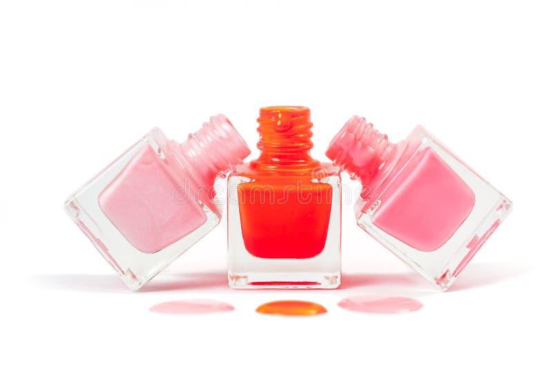 Stack of pink nail polish isolated on white background. Stack of pink nail polish isolated on the white background stock photo