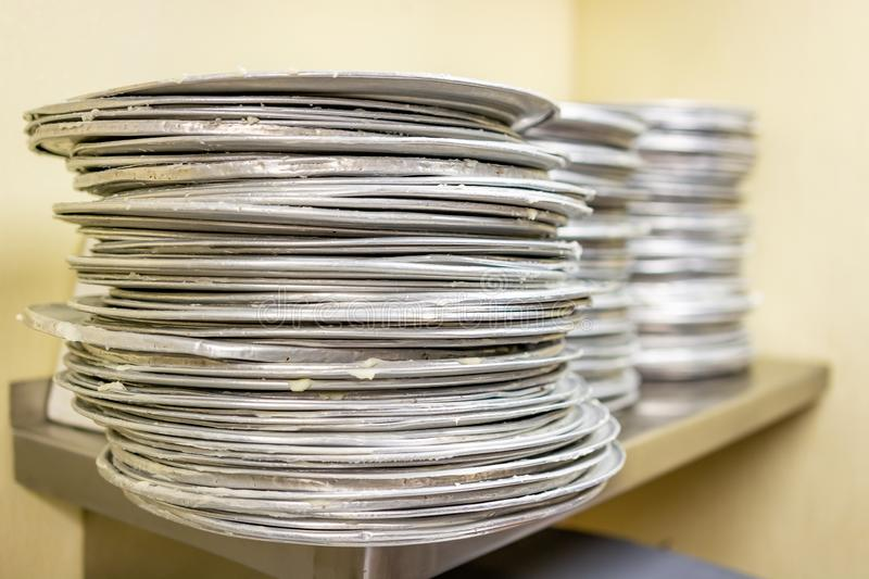 Stack of pizza pans royalty free stock images