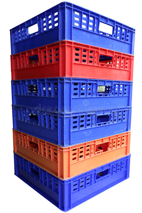 Stack of plastic crates. Isolated on white background royalty free stock photo