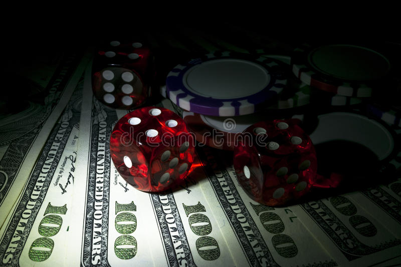 Stack of Poker chips with dice rolls on a dollar bills, Money. Poker table at the casino. Poker game concept. Playing a game. With dice. Casino dice rolls royalty free stock images