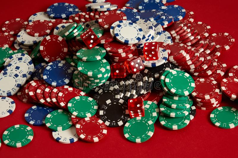 Stack of poker chips on red background at casino royalty free stock images