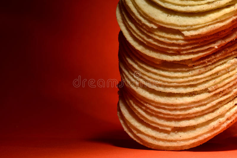 Download Stack Of Potato Chips On Orange Stock Photo - Image: 36577288