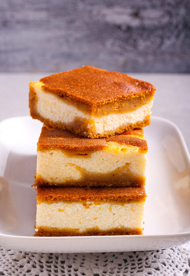 Stack of pumpkin cheesecake bars royalty free stock image