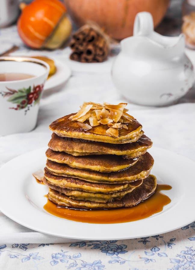 Stack of pumpkin pancakes. Pumpkin pancakes with orange juice and cinnamon royalty free stock photos