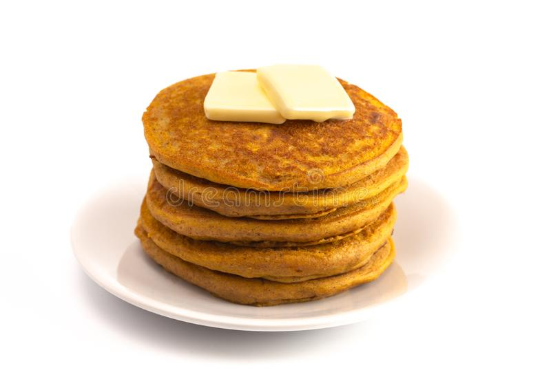 Stack of Pumpkin Spice Flavored Pancakes Isolated on a White Background. A Stack of Pumpkin Spice Flavored Pancakes Isolated on a White Background stock photography