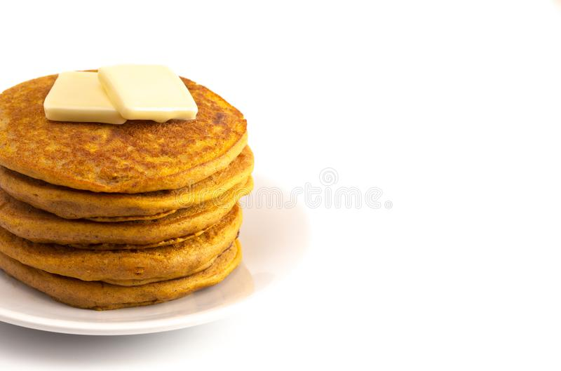 Stack of Pumpkin Spice Flavored Pancakes Isolated on a White Background. A Stack of Pumpkin Spice Flavored Pancakes Isolated on a White Background royalty free stock image