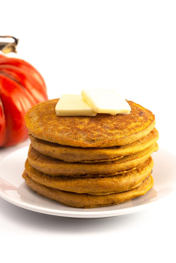 Stack of Pumpkin Spice Flavored Pancakes Isolated on a White Background. A Stack of Pumpkin Spice Flavored Pancakes Isolated on a White Background royalty free stock photos