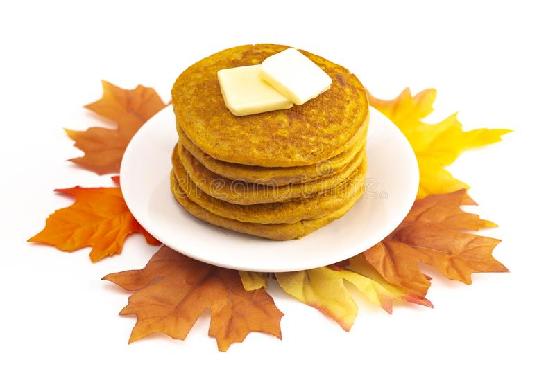 Stack of Pumpkin Spice Flavored Pancakes Isolated on a White Background. A Stack of Pumpkin Spice Flavored Pancakes Isolated on a White Background royalty free stock images