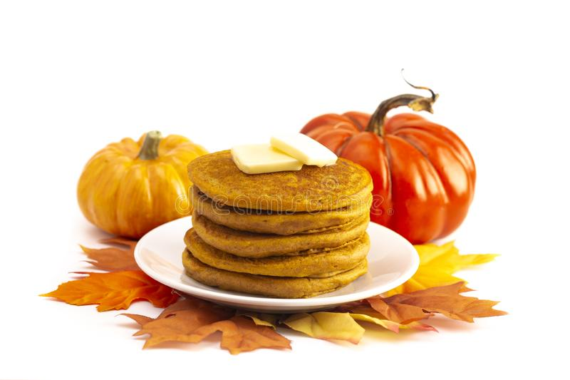Stack of Pumpkin Spice Flavored Pancakes Isolated on a White Background. A Stack of Pumpkin Spice Flavored Pancakes Isolated on a White Background stock images