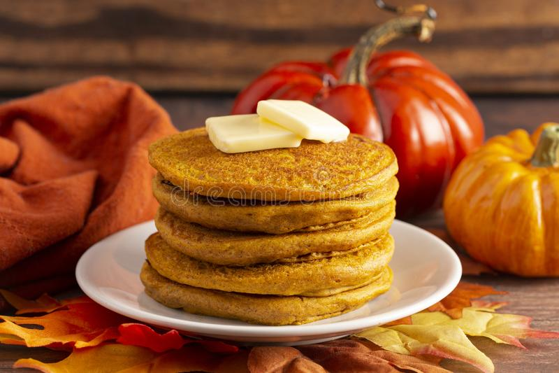 Stack of Pumpkin Spice Flavored Pancakes on a Wooden Table. A Stack of Pumpkin Spice Flavored Pancakes on a Wooden Table stock images