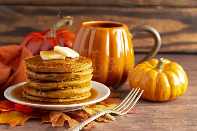 Stack of Pumpkin Spice Flavored Pancakes on a Wooden Table. A Stack of Pumpkin Spice Flavored Pancakes on a Wooden Table stock image