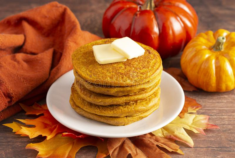 Stack of Pumpkin Spice Flavored Pancakes on a Wooden Table. A Stack of Pumpkin Spice Flavored Pancakes on a Wooden Table royalty free stock photos