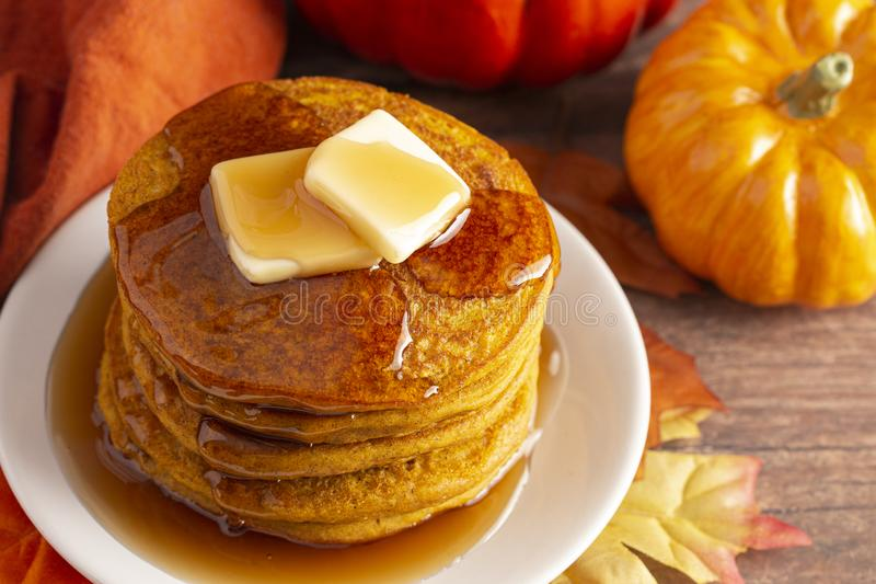 Stack of Pumpkin Spice Flavored Pancakes on a Wooden Table. A Stack of Pumpkin Spice Flavored Pancakes on a Wooden Table royalty free stock photography