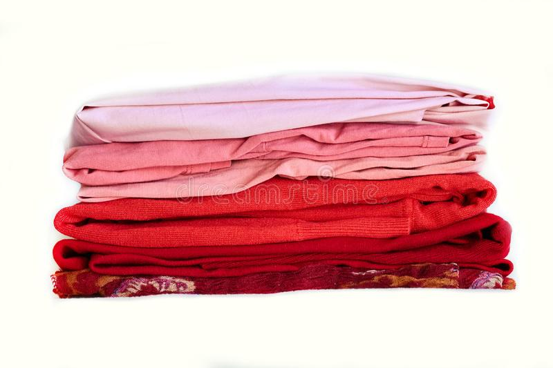 Stack purple winter clothes isolated on white background. royalty free stock image