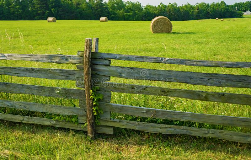 Stack Rail Fence and Round Hay Bales stock photos