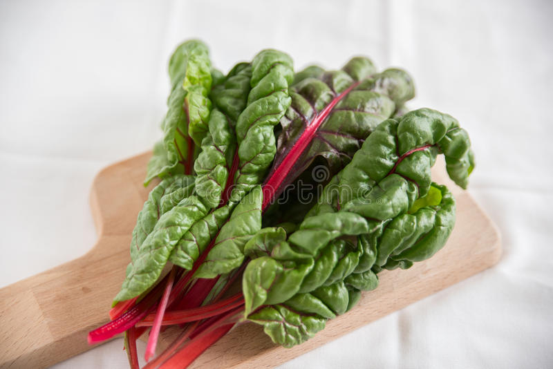 Stack of Rainbow Chard Leaves. On a table stock photos