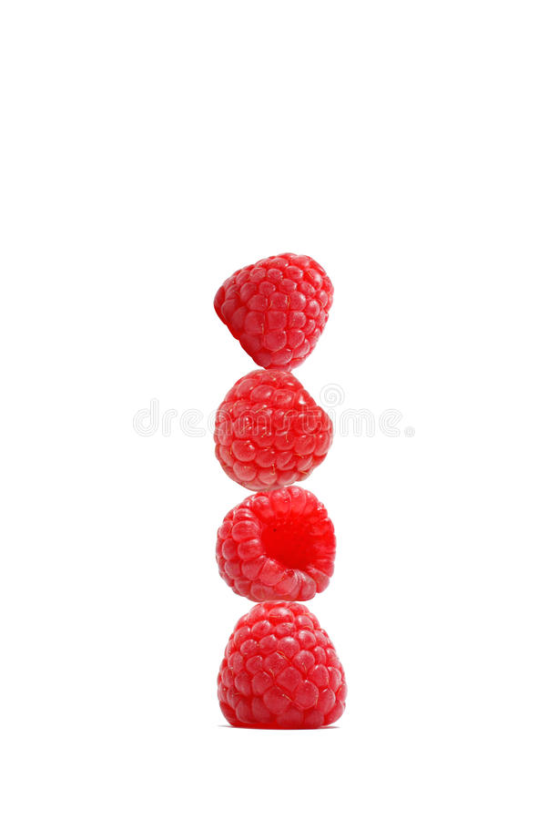Stack of raspberries. Stack of four red raspberries, isolated on white background stock image