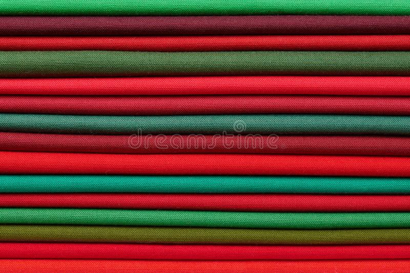 Stack of red and green fabrics as a vibrant background image royalty free stock photography