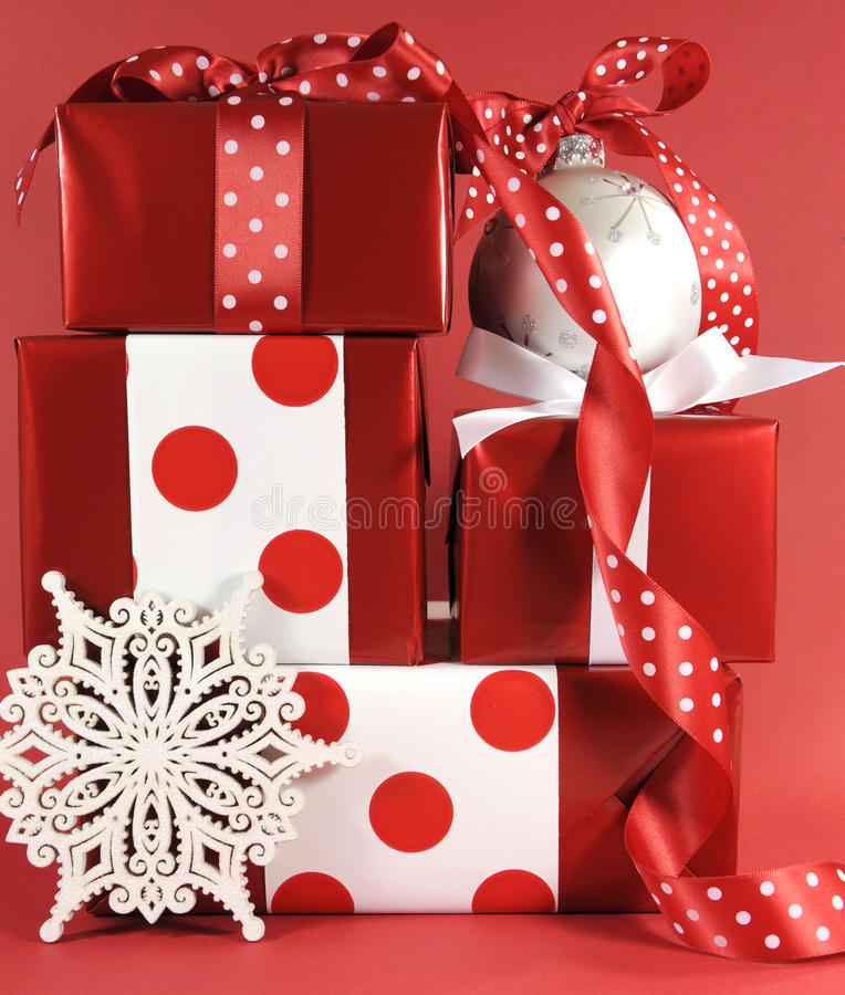 Stack of red and white polka dot theme festive gift box presents with ornaments royalty free stock image