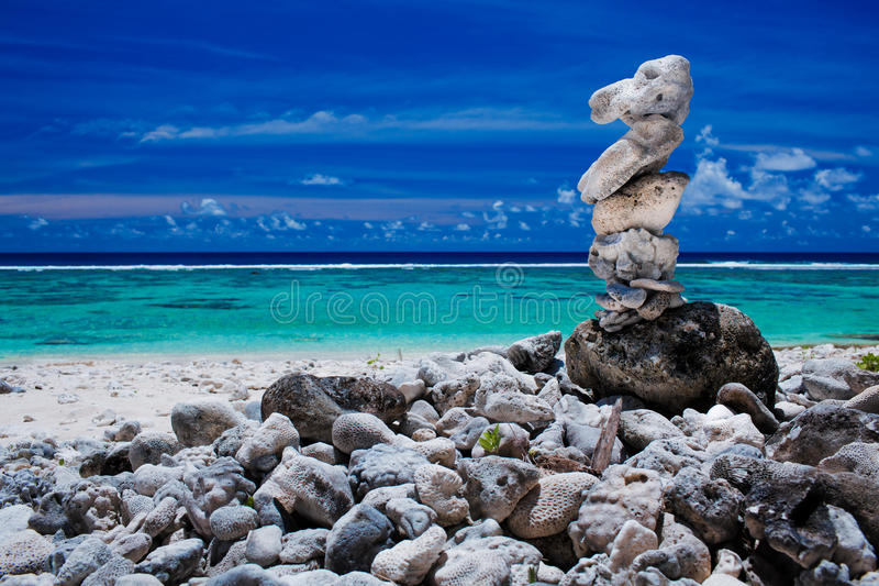 Stack of reef stones on a sky and lagoon