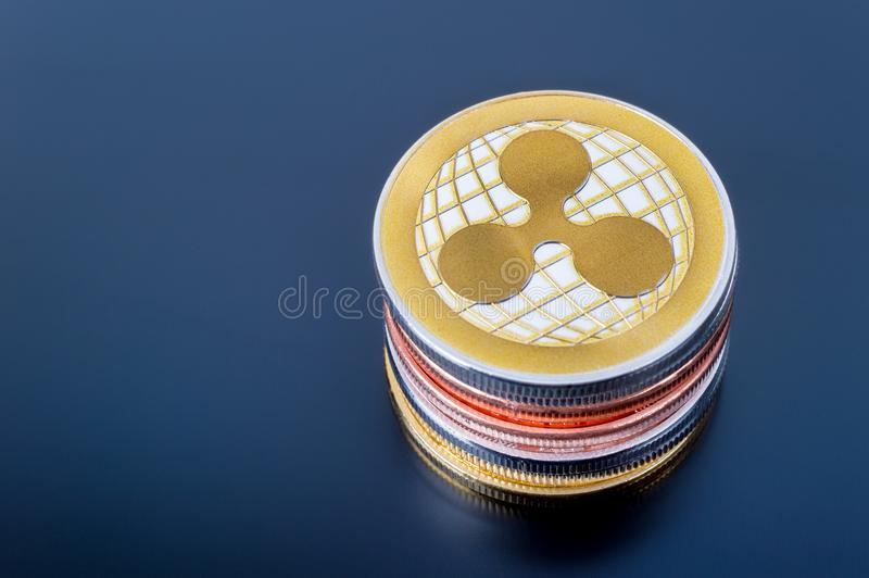 Stack of Ripple XRP cryptocurrency real coins. Montreal, CA - 16 April 2018: Stack of Ripple XRP cryptocurrency real coins over tablet screen royalty free stock photography