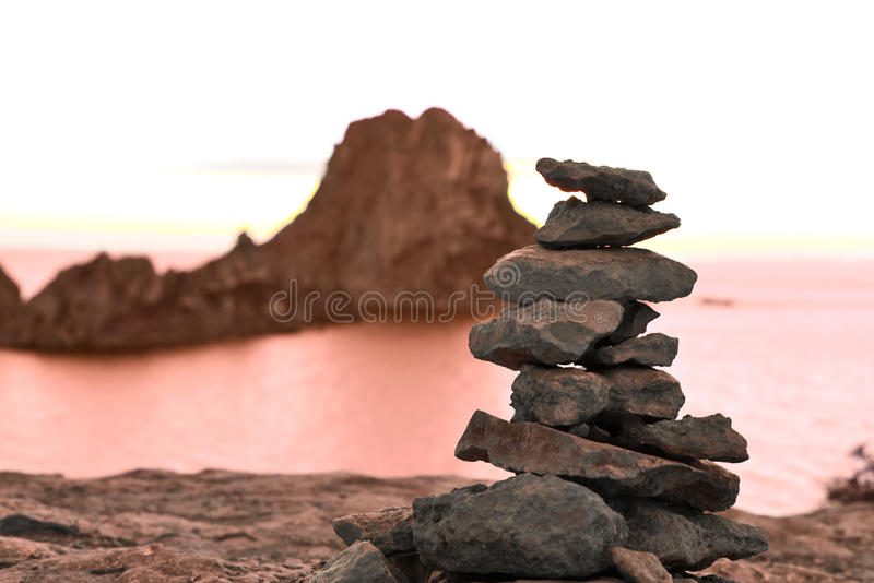 Stack rock at Es Vedra, Ibiza Island. Sunset scene with rock formation royalty free stock photos