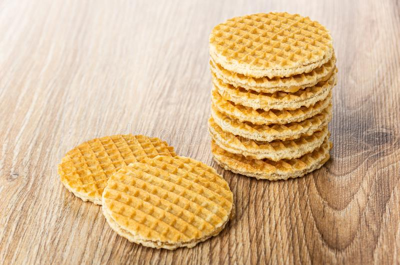 Stack of round wafers with filling on table stock images