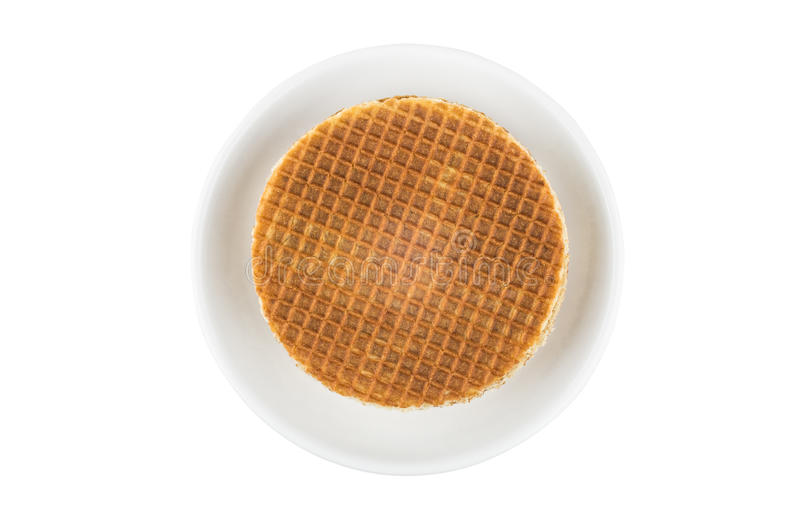 Stack of round waffles in glass saucer. Isolated on white background, top view royalty free stock photography
