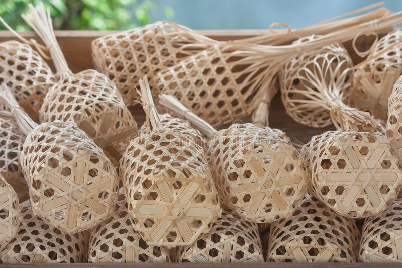 Stack or row of brown round bamboo market in wooden tray. Close up stack or row of brown round bamboo market in wooden tray stock photography