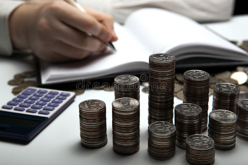 Stack of Russian coins on the background of working as an accountant stock images