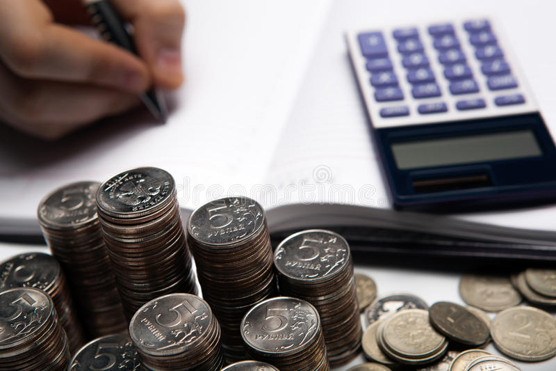 Stack of Russian coins on the background of working as an accountant stock image