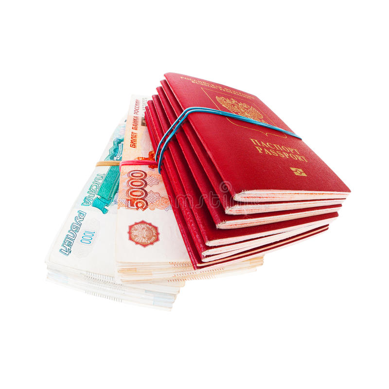 Stack of russian passports and money. Isolated on white background royalty free stock photos