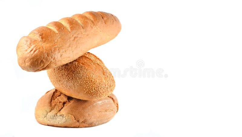 Stack of rye, wheat loaves of bread isolated on white. royalty free stock image