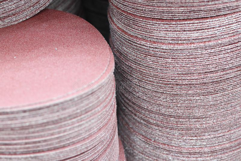 The Stack of sand paper disk. For manufacturing process white equipment tool background sandpaper disc work circle construction industry wheel abrasive royalty free stock images